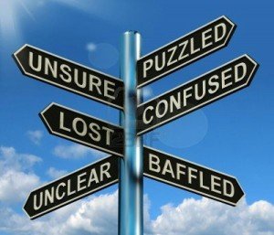 wpid-13564622-puzzled-confused-lost-signpost-shows-puzzling-problem1